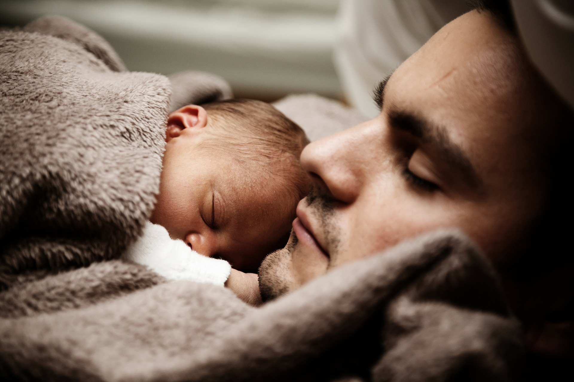 Sleeping father and infant