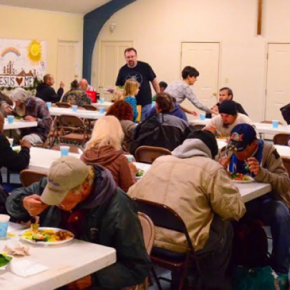 group of people eating at homeless shelter