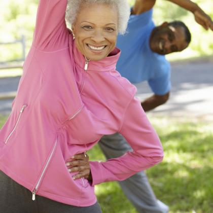 older couple exercising outside